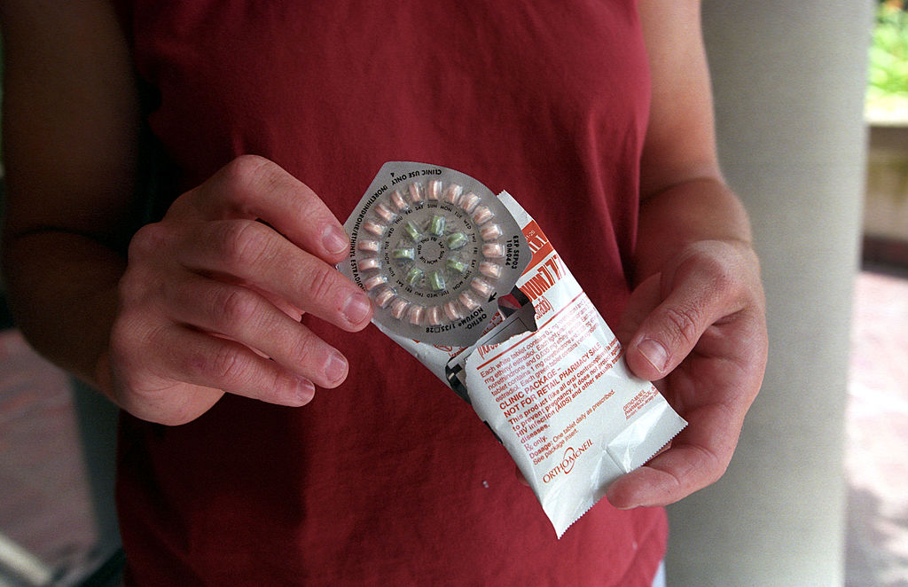 A woman holds prescription contraceptives