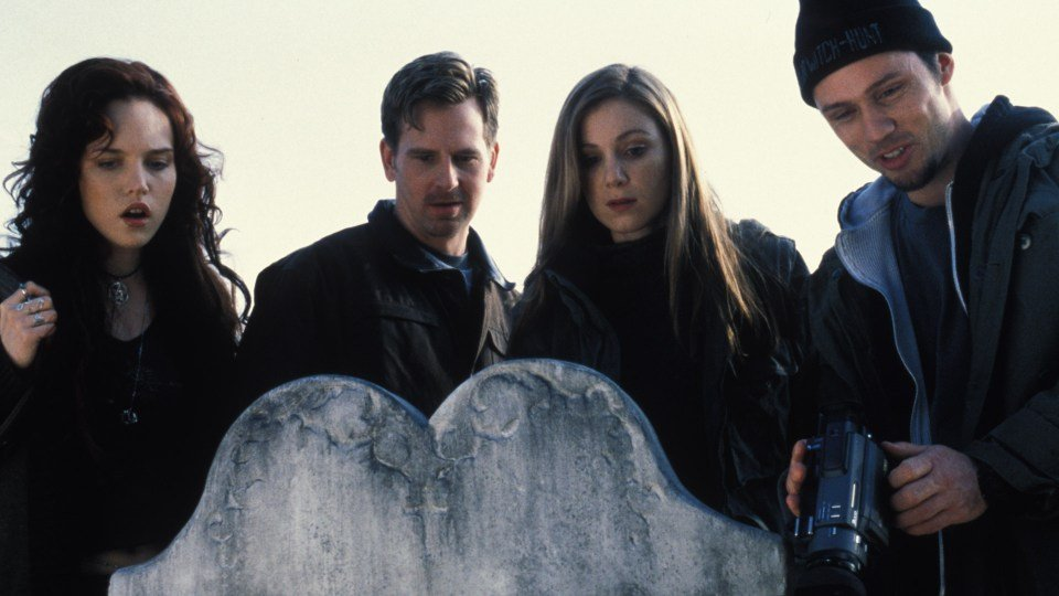 The cast of Book of Shadows all stand over a headstone