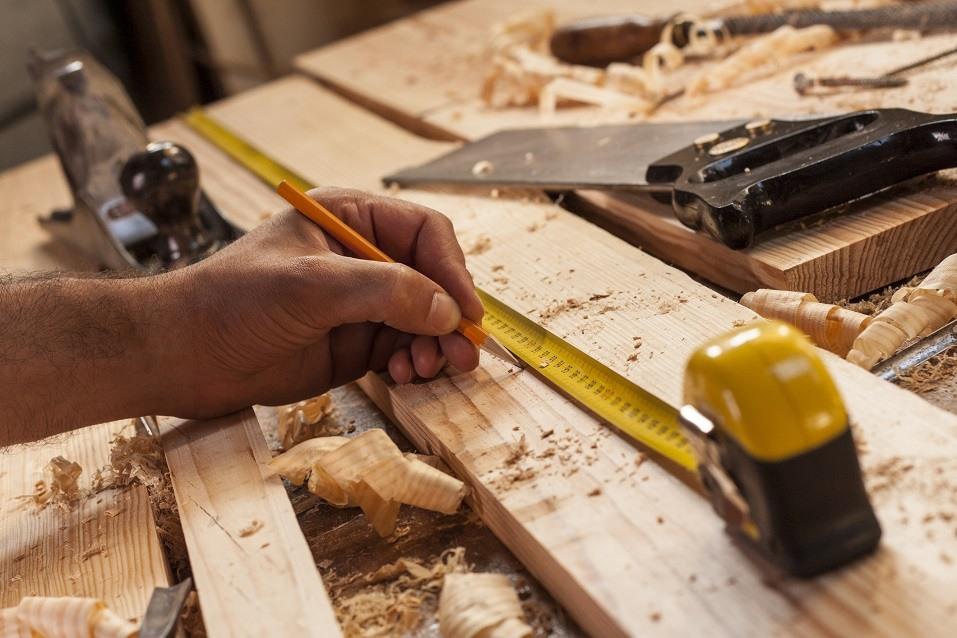 carpenter taking measurement