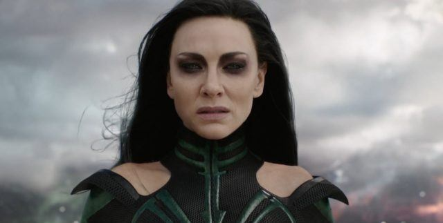 Cate Blanchett dons dark hair and a black costume as Hela in Thor: Ragnarok staring straight ahead.