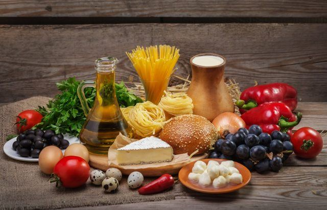 Set of different foods on the old wooden background