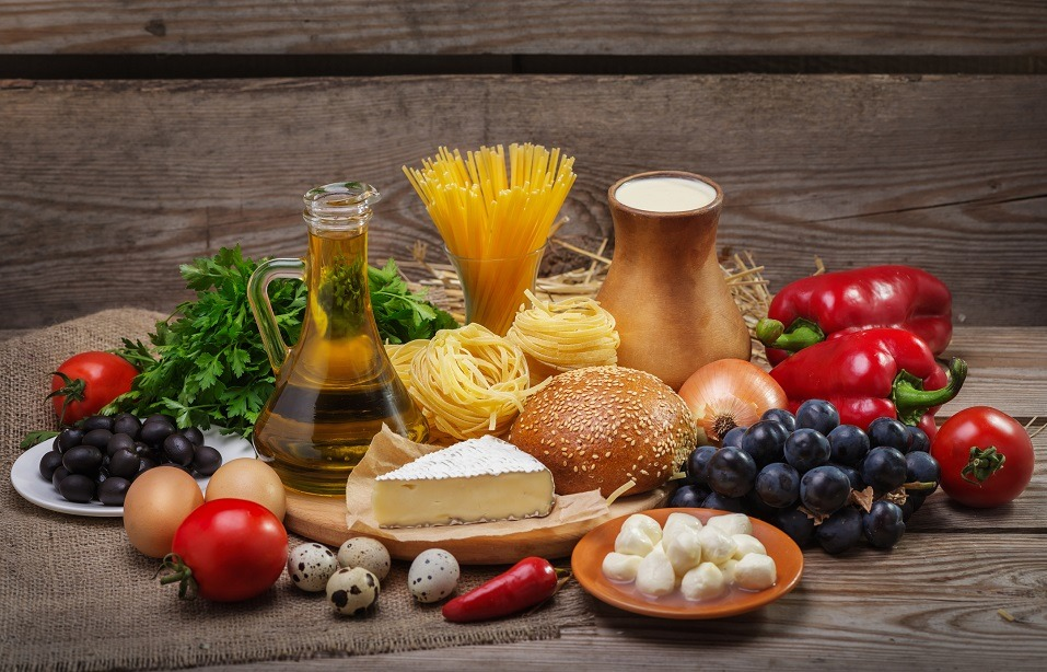 Different foods on a wooden background