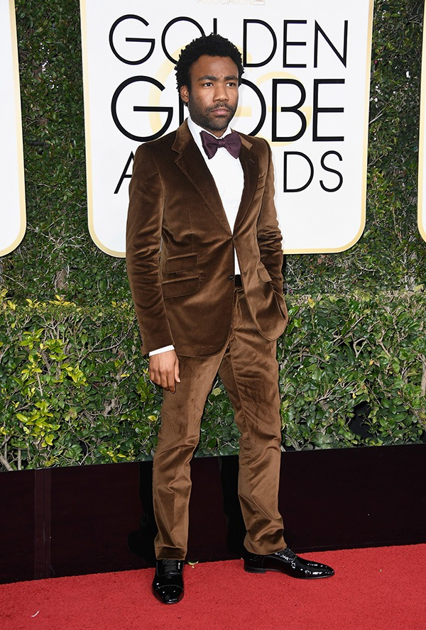 Donald Glover in a brown suit