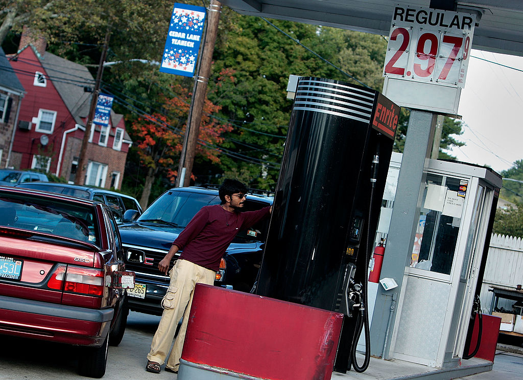 TEANECK, NJ - OCTOBER 06: A service station attendant pumps gasoline at $2.97 a gallon October 6, 2008 in Teaneck, New Jersey. Gasoline prices are falling in many parts of the nation.