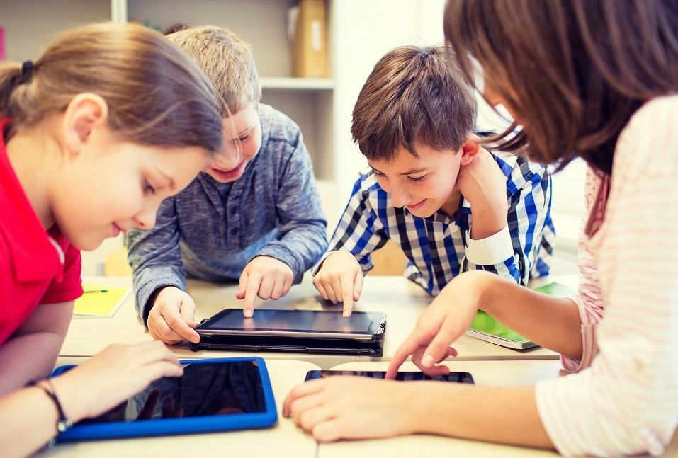 A group of students works on their tablets
