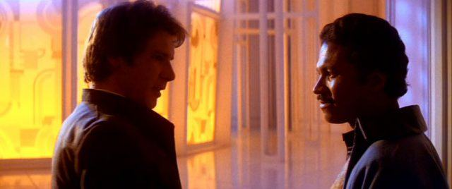 Han Solo and Lando Calrissian staring straight at each other.