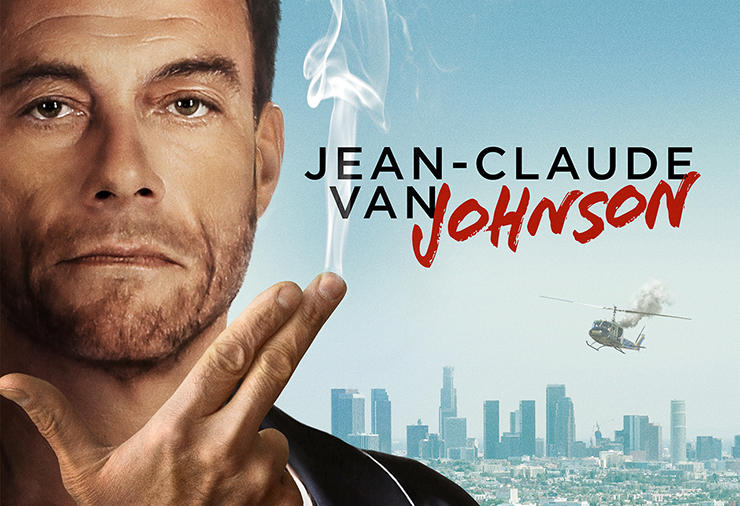 Jean Claude holds up his fingers like a gun
