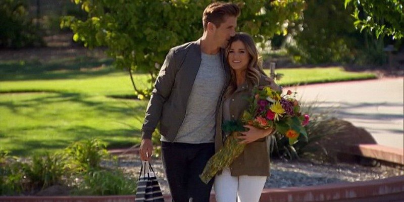 JoJo holds flowers while walking next to a man on The Bachelorette