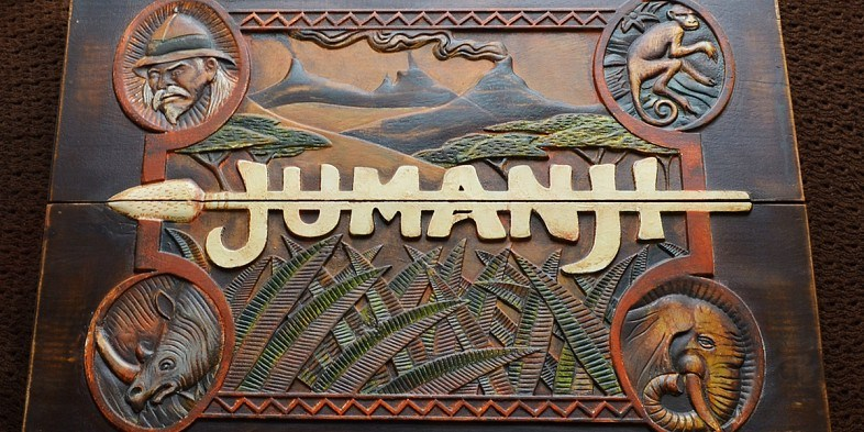 The outside of the game box for Jumanji, with the logo on the front with an arrow through the letters
