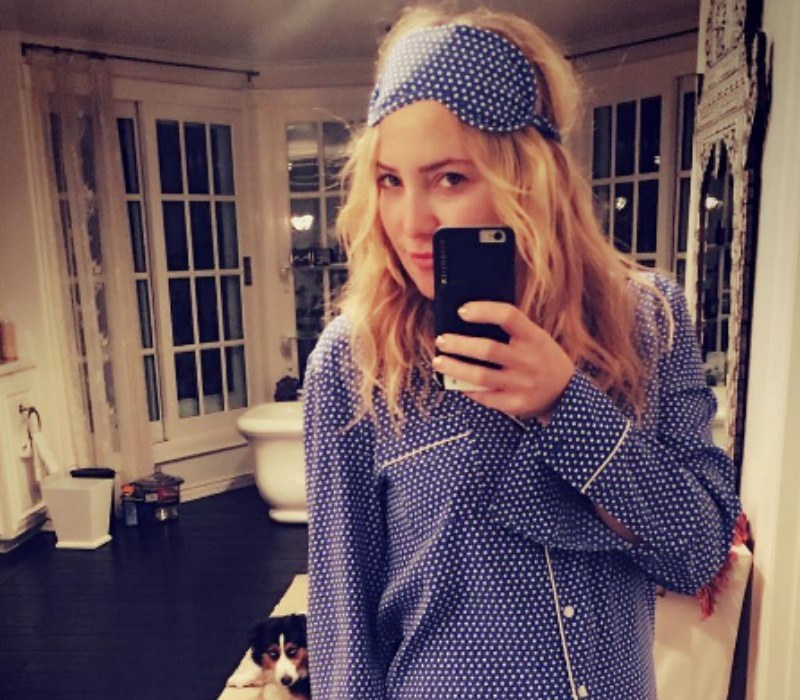 Kate Hudson poses in polka dot pajamas and a matching eye mask.