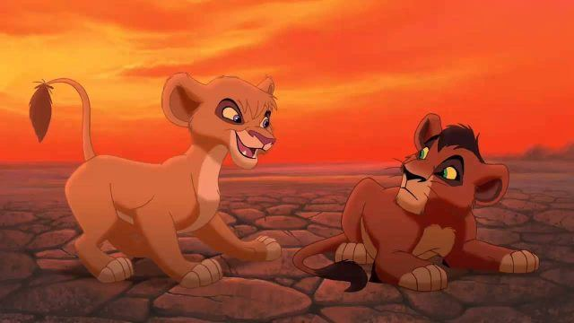 Two cubs playfully fight in 'The Lion King 2'.