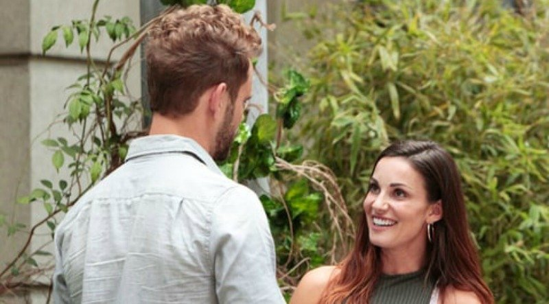 Liz looks up smiling at Nick on The Bachelor