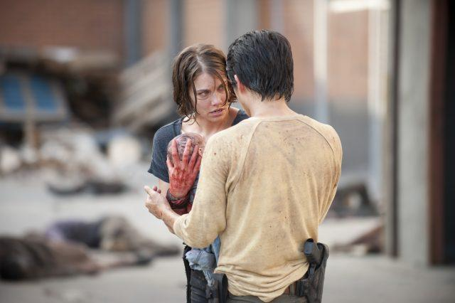 """Maggie carries a newborn Judith to Glenn in a scene from 'The Walking Dead' episode """"The Killer Within"""""""