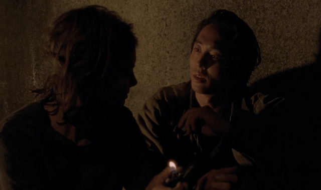"Maggie flicks a lighter on while talking to Glenn in a scene from 'The Walking Dead' episode, ""Us"""