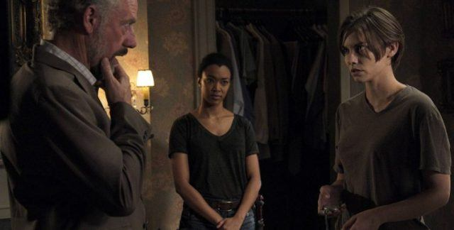 "Maggie stares Gregory down while Sasha watches in a scene from 'The Walking Dead' episode ""Go Getters"""