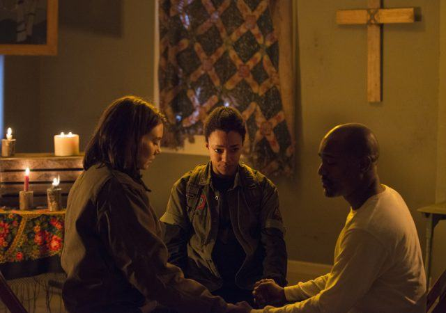 "Maggie, Sasha and Gabriel sit in a circle and pray together in a scene from 'The Walking Dead' episode ""Conquer"""
