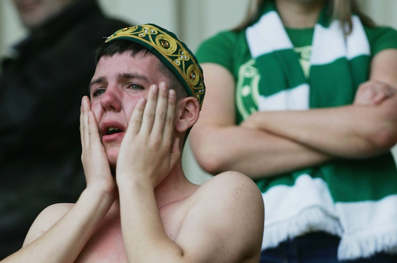 A Celtic fan cries following a loss