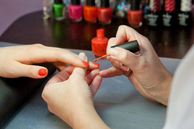 hands of the manicurist and the client
