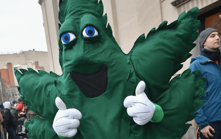 A cannabis mascot gives a thumbs up