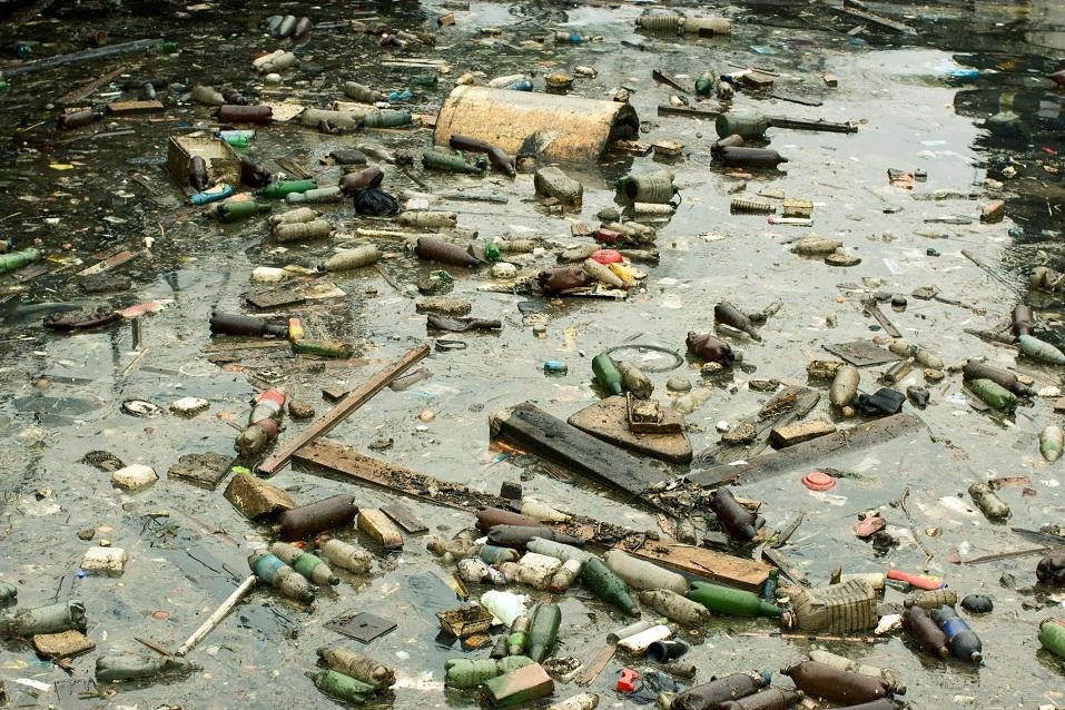 Trash and oil pollutes a beach