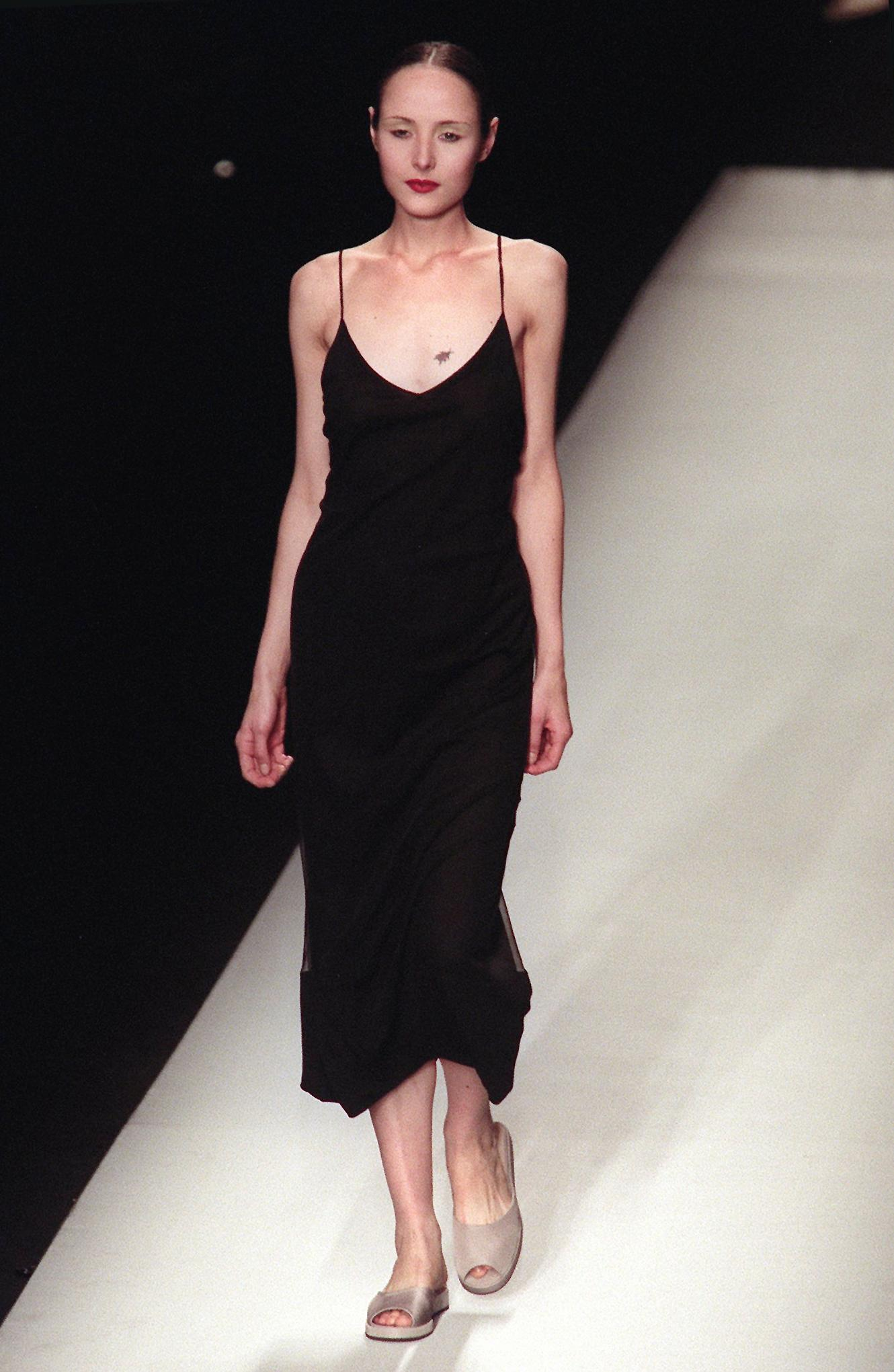 A model wears a black slip dress during the John Bartlett fashion show