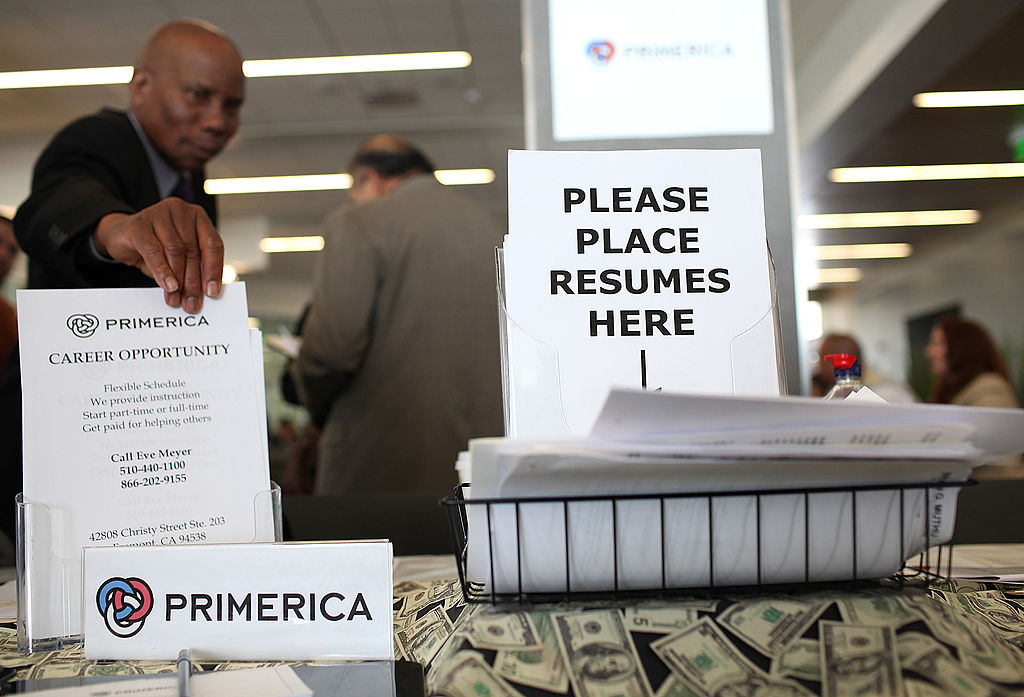 Resumes sit in a basket at the Primerica booth during the Job Hunter's Boot Camp