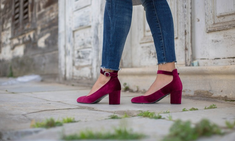 Woman with purple high heal shoes