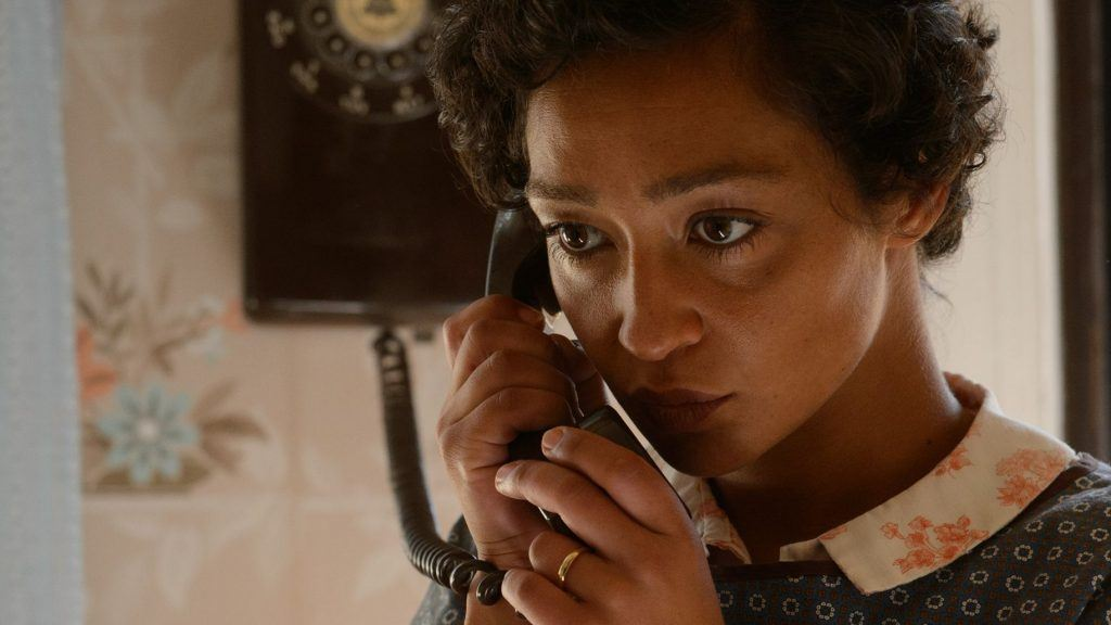 Ruth Negga talking into an old-fashioned phone in Loving