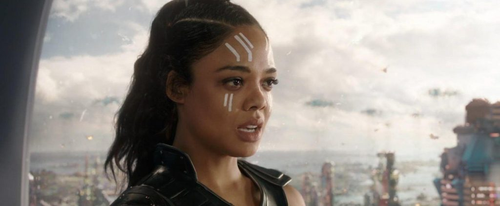 Tessa Thompson as Valkyrie in Thor: Ragnarok lookign shocked with the city in the distance