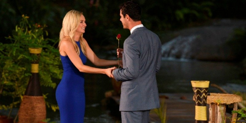 Ben Higgins is giving Lauren Bushnell a rose on The Bachelor.