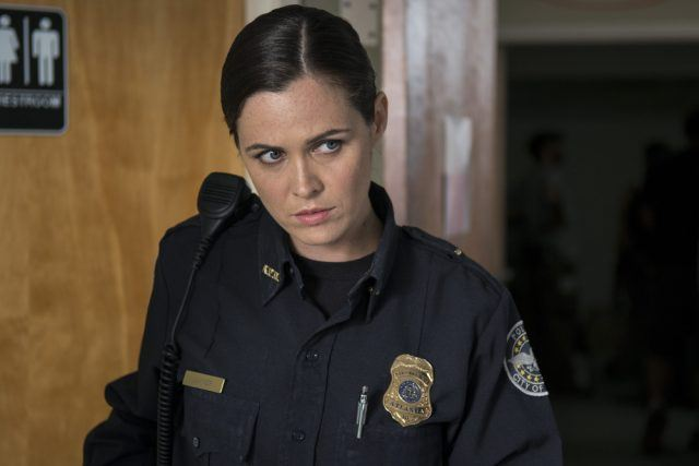 """Dawn (Christine Woods) looks suspicious in a scene from 'The Walking Dead' episode """"Slabtown"""""""