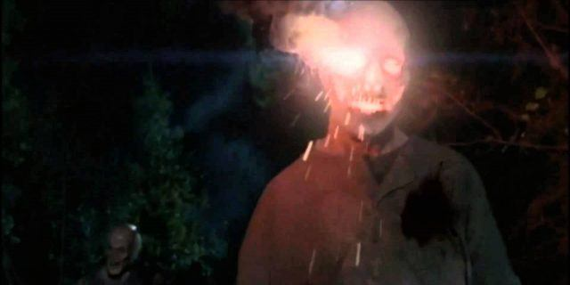 """A walker's head is lit with a flare in a scene from the Season 5 episode of 'The Walking Dead,' """"The Distance"""""""