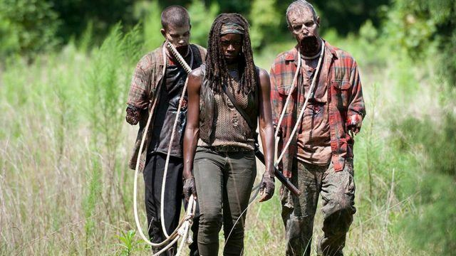 Michonne (Danai Gurira) walks with her two walkers on leashes in a scene from 'The Walking Dead'