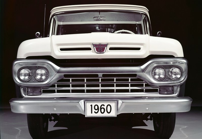 A front-facing Ford F-100 from 1960