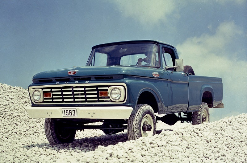 1963 Ford F-250 sits parked on a rocky terrain