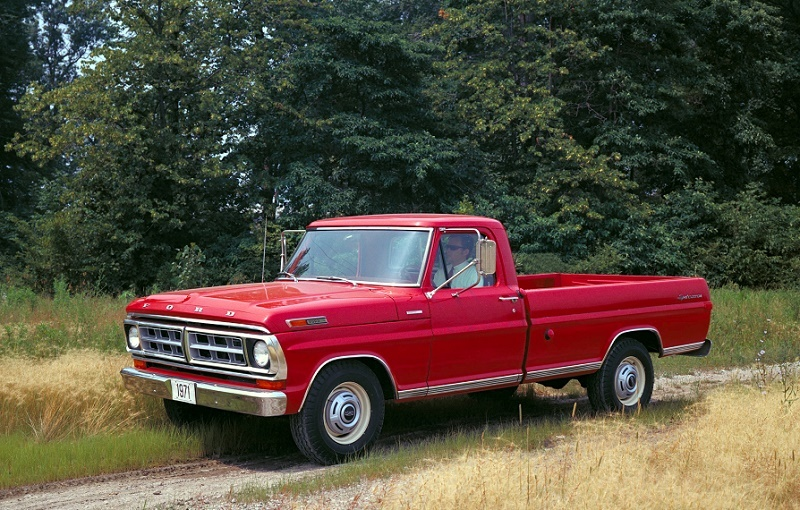 1971 Ford F-250 sits parked in the grass