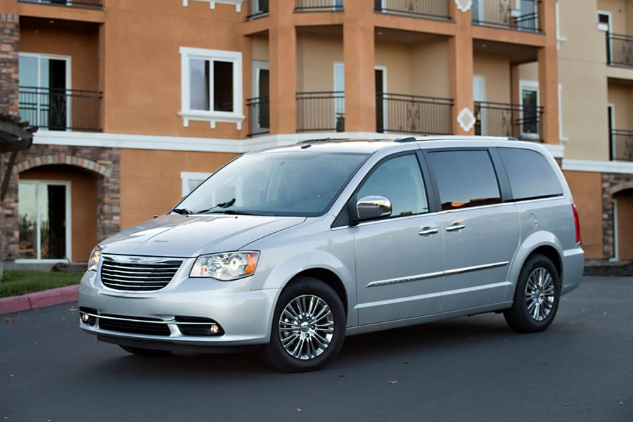 The 2013 Chrysler Town and Country in silver.