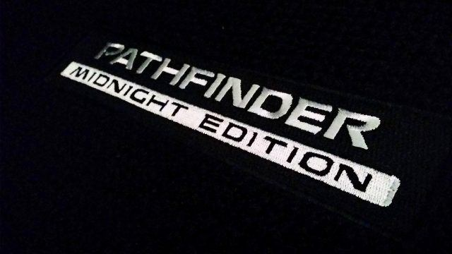 Midnight Edition Pathfinder floor mats in all of their white-stitched glory