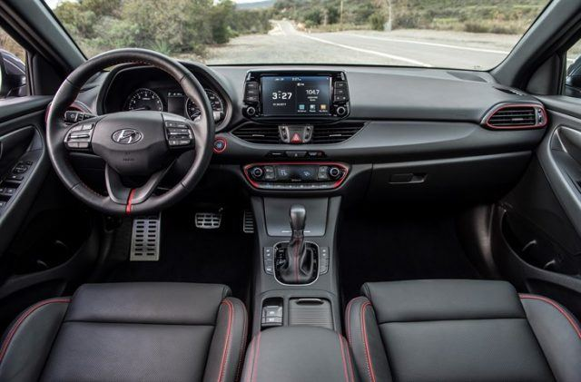 The front seats and dashboard of the 2018 Hyundai Elantra GT Sport
