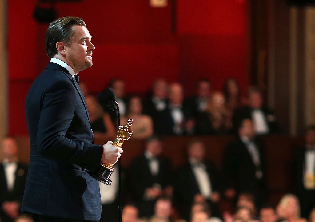 Actor Leonardo DiCaprio accepts the Oscar statue the Best Performance by an Actor in a Leading Role award for 'The Revenant'