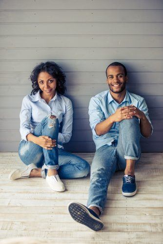 Young couple in matching blue shirts and jeans