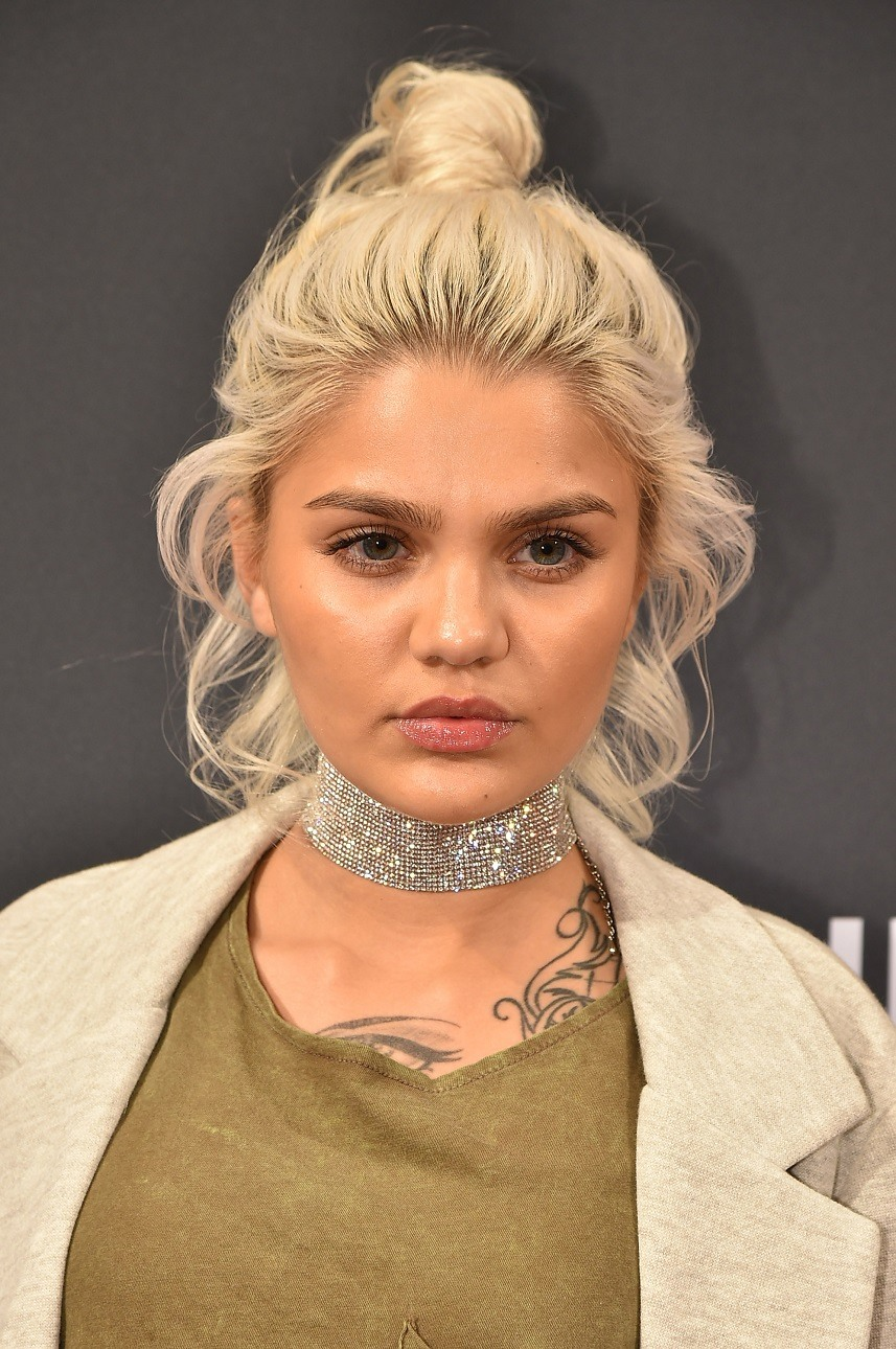 Amina Blue attends the UNIQLO Fall/Winter 2016 Carine Roitfeld collection launch