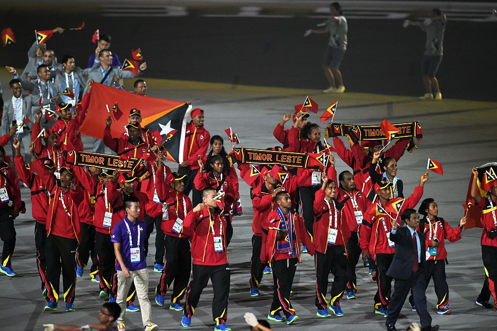 Athletes from East Timor march during at the opening ceremony of the biennial Southeast Asian (SEA) Games