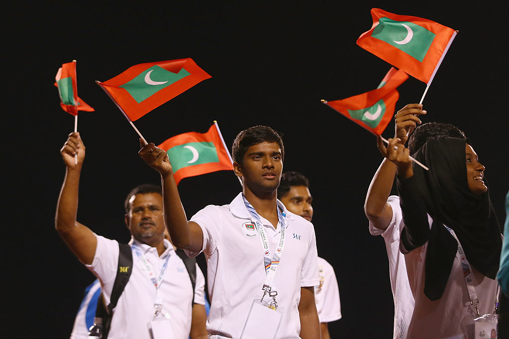 Athletes from the Maldives team waves flags
