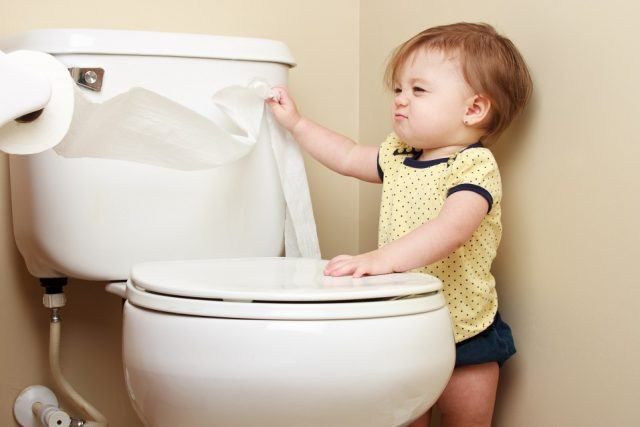 baby pulling toilet paper