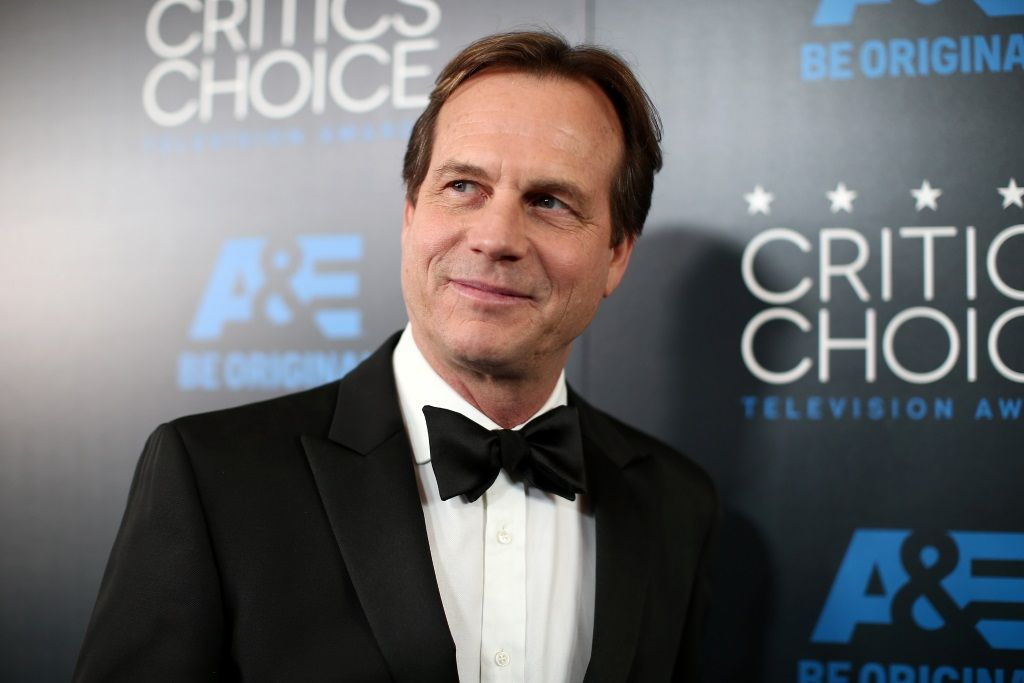 Bill Paxton on the red carpet, looking to his right and smiling