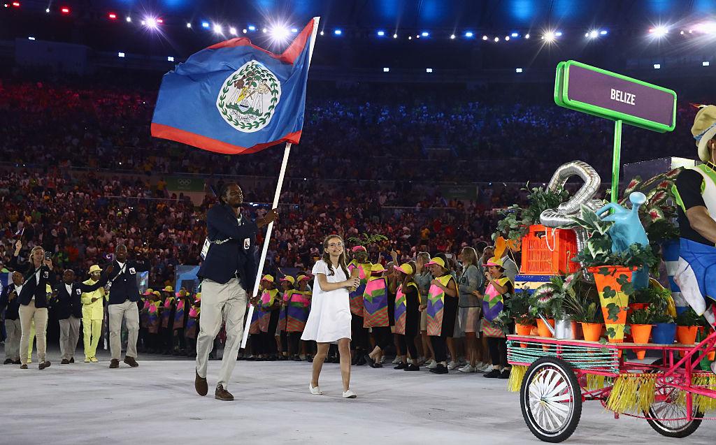 Brandon Jones of Belize carries the flag