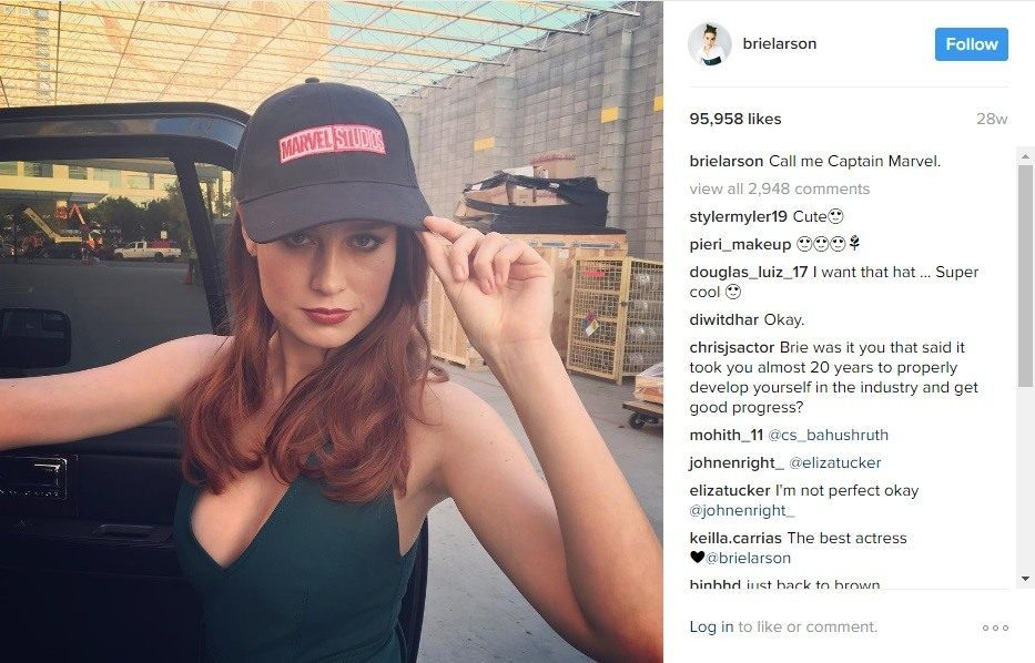 Actress Brie Larson wears a Marvel studios hat while announcing she will play the role of Captain Marvel