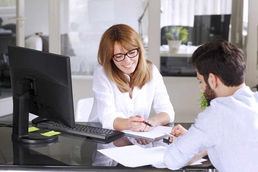 Insurance agent gives advice to her client