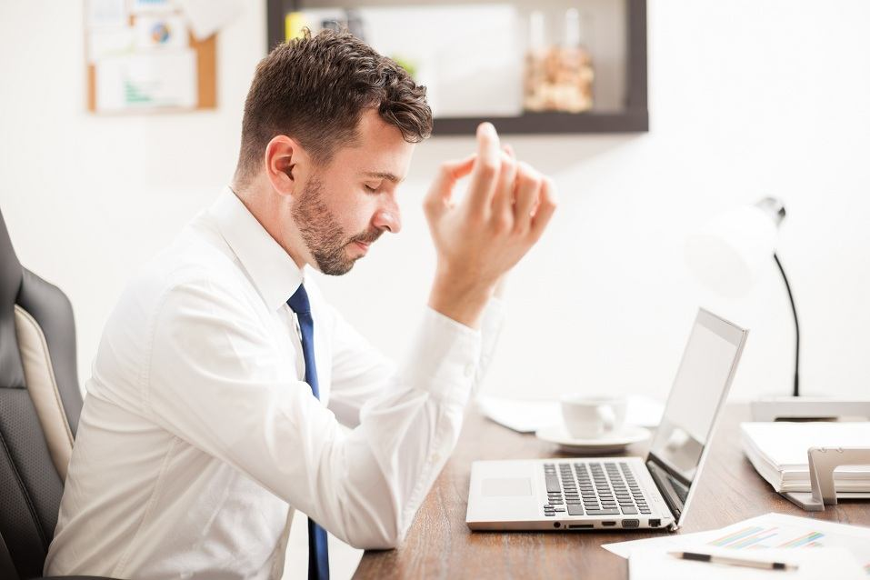 A man struggles to remain calm after being hit with a deluge of buzzwords on a resume